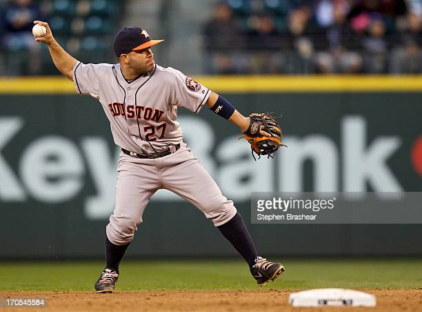Jose Altuve of the Houston Astros throws the ball to first base during a game against the Seattle Mariners at Safeco Field on June 11 2013 in Seattle...