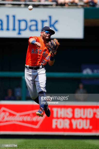 Jose Altuve of the Houston Astros throws to first base against the St. Louis Cardinals in the third inning at Busch Stadium on July 28, 2019 in St...