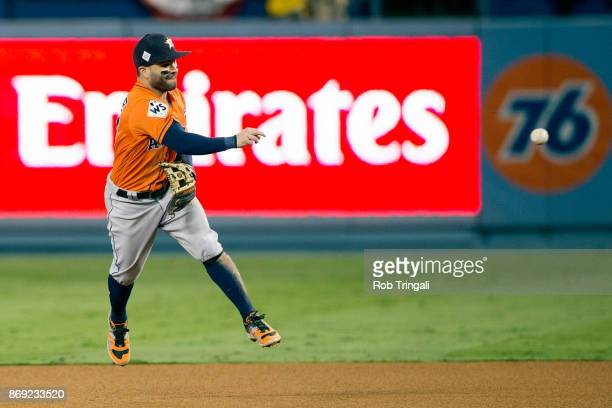 Jose Altuve of the Houston Astros throws to first base for the final out of Game 7 of the 2017 World Series against the Los Angeles Dodgers at Dodger...