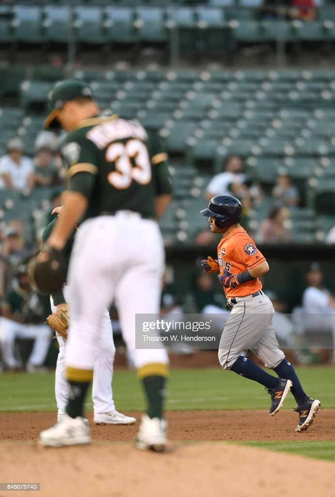 Jose Altuve #27 of the Houston Astros trots around the bases after hitting a two-run homer off of Daniel Mengden #33 of the Oakland Athletics in the top of the six inning of the second game in a double header at Oakland Alameda Coliseum on September 9, 2017 in Oakland, California.