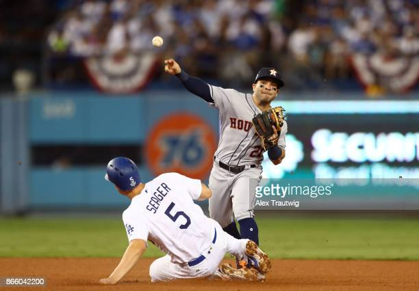 Jose Altuve of the Houston Astros turns a double play to end the fifth inning of Game 1 of the 2017 World Series against the Los Angeles Dodgers at...