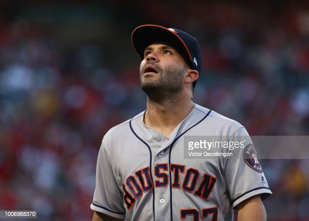 Jose Altuve of the Houston Astros walks back to the dugout after the first inning of the MLB game against the Los Angeles Angels of Anaheim at Angel...