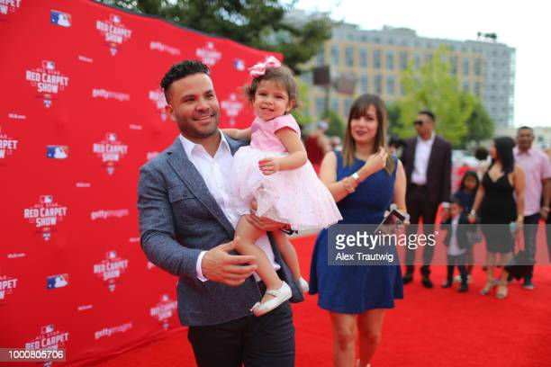 Jose Altuve of the Houston Astros walks the red carpet with his family during the MLB Red Carpet Show at Nationals Park on Tuesday July 17 2018 in...