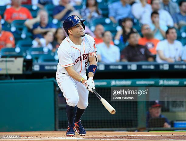 Jose Altuve of the Houston Astros watches a solo home run in the first inning off Phil Hughes of the Minnesota Twins during their game at Minute Maid...
