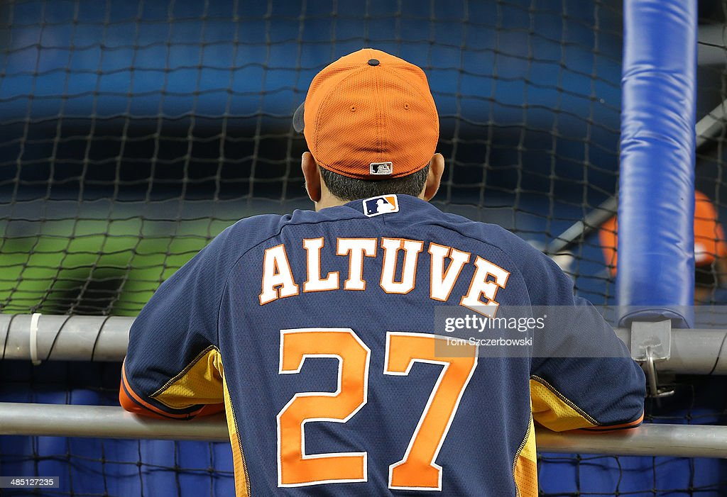 Jose Altuve #27 of the Houston Astros watches batting practice through the batting cage before MLB game action against the Toronto Blue Jays on April 9, 2014 at Rogers Centre in Toronto, Ontario, Canada.