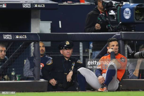 Jose Altuve of the Houston Astros watches from the dugout during Game 5 of the American League Championship Series against the New York Yankees at...