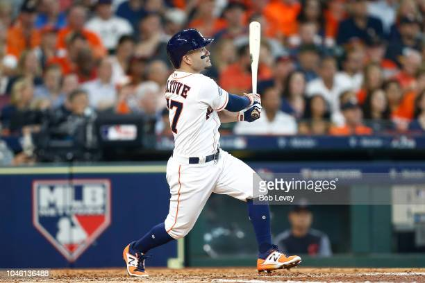 Jose Altuve of the Houston Astros watches his solo home run in the fifth inning off Corey Kluber of the Cleveland Indians during Game One of the...