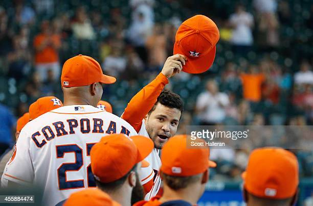 Jose Altuve of the Houston Astros waves to the crowd after leaving the game in the ninth inning of their game against the Seattle Mariners at Minute...