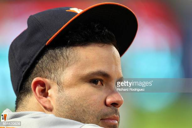Jose Altuve of the Houston Astros who was hit by a pitch in Monday's game watches from the dugout in the first inning of a basbeall game against the...