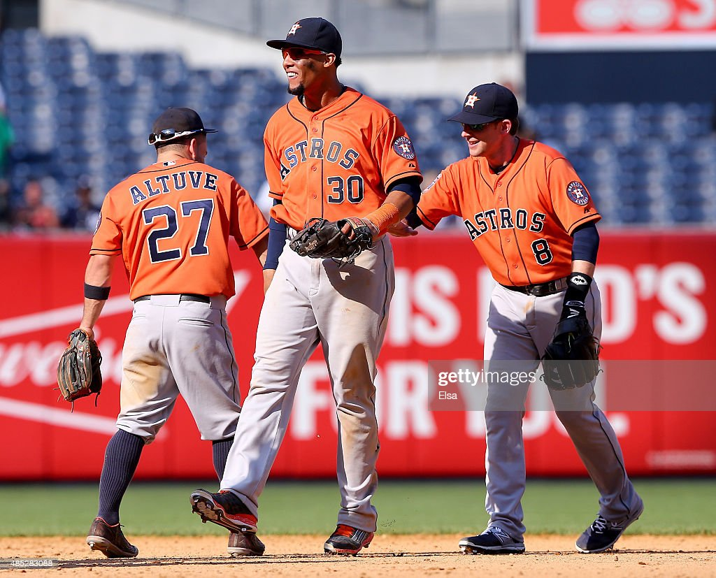 Jose Altuve #27,Carlos Gomez #30 and Jed Lowrie #8 of the Houston Astros celebrate the 6-2 win over the New York Yankees on August 26, 2015 at Yankee Stadium in the Bronx borough of New York City.