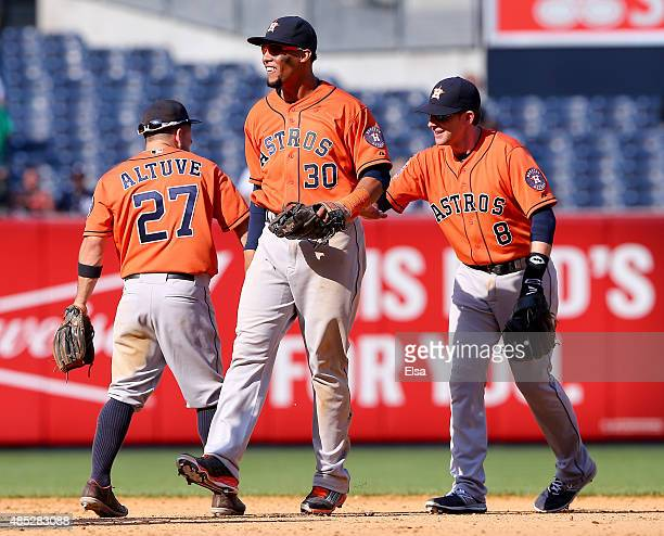 Jose AltuveCarlos Gomez and Jed Lowrie of the Houston Astros celebrate the 62 win over the New York Yankees on August 26 2015 at Yankee Stadium in...
