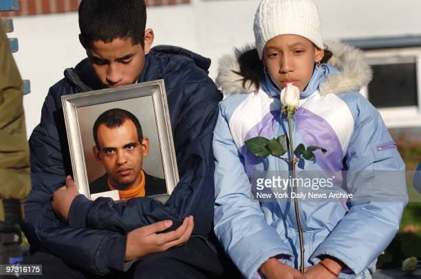 Jose Alvarado and Rafalina Fernandez mourn their uncle Pedro Brito Rodriguez during a memorial service this morning on the fourth anniversary of the...