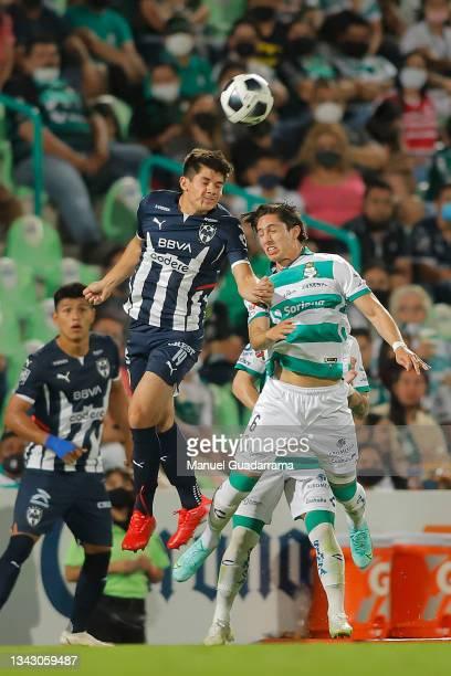 Jose Alvarado of Monterrey struggles for the ball with Alan Cervantes of Santos during the 10th round match between Santos Laguna and Monterey as...