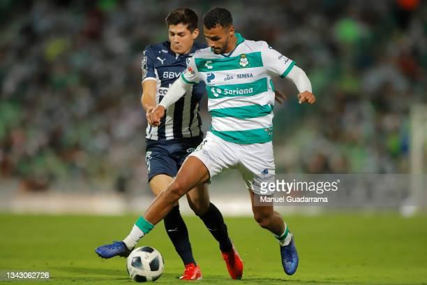 Jose Alvarado of Monterrey struggles for the ball with Alessio da Cruz of Santos during the 10th round match between Santos Laguna and Monterey as...