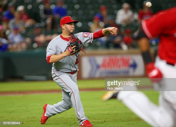 Jose Alvarez of the Los Angeles Angels of Anaheim throws the runner out in the seventh inning against the Texas Rangers at Globe Life Park in...