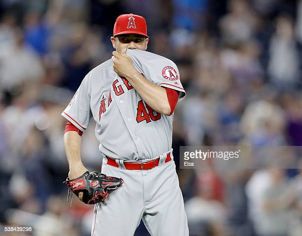 Jose Alvarez of the Los Angeles Angels reacts after giving up a three run home run to Carlos Beltran of the New York Yankees at Yankee Stadium on...