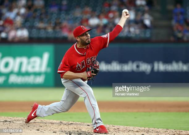 Jose Alvarez of the Los Angeles Angels throws against the Texas Rangers in the third inning at Globe Life Park in Arlington on August 16 2018 in...