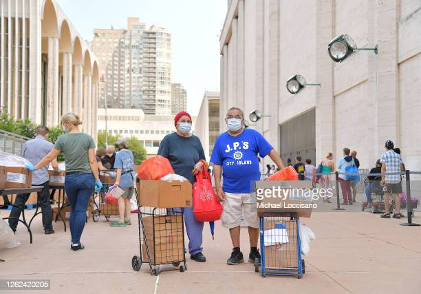 Jose and his wife are one of many New Yorkers in need to receive free produce dry goods and meat at a Food Bank For New York City distribution event...