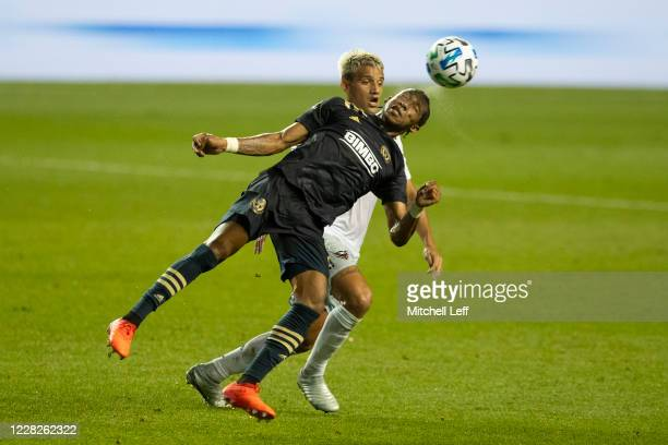 Jose Andres Martinez of Philadelphia Union competes for the ball against Yamil Asad of D.C. United in the first half at Subaru Park on August 29,...