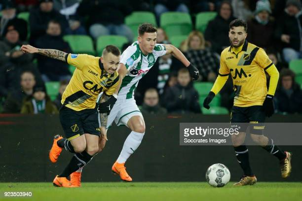 Jose Angel Esmoris Tasende Angelino of NAC Breda Ajdin Hrustic of FC Groningen during the Dutch Eredivisie match between FC Groningen v NAC Breda at...