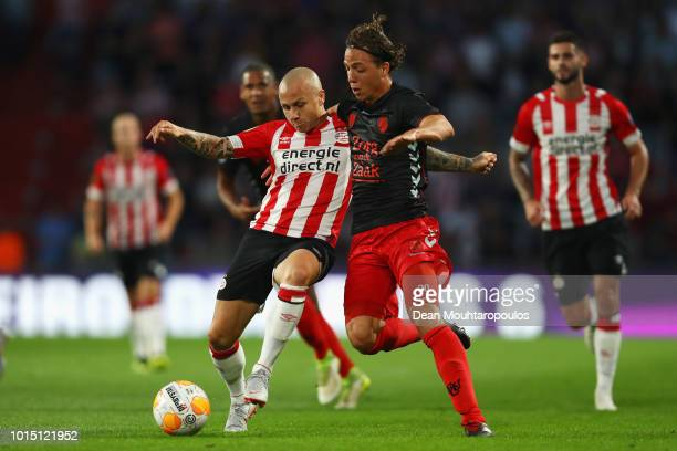 Jose Angel Esmoris Tasende Angelino of PSV battles for the ball with Giovanni Troupee of FC Utrecht during the Eredivisie match between PSV and...