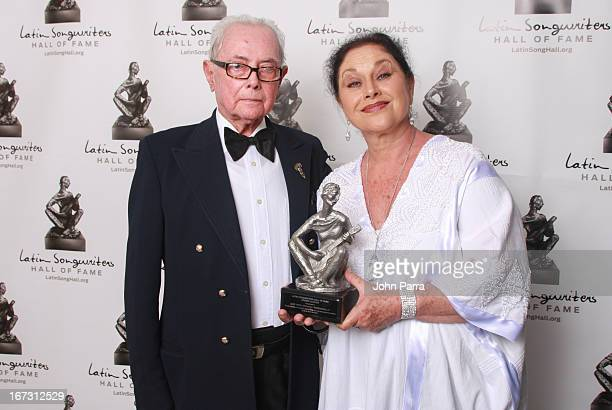 Jose Angel Espinoza and Angelica Aragon pose backstage at the Latin Songwriters Hall of Fame Gala at New World Center on April 23 2013 in Miami Beach...