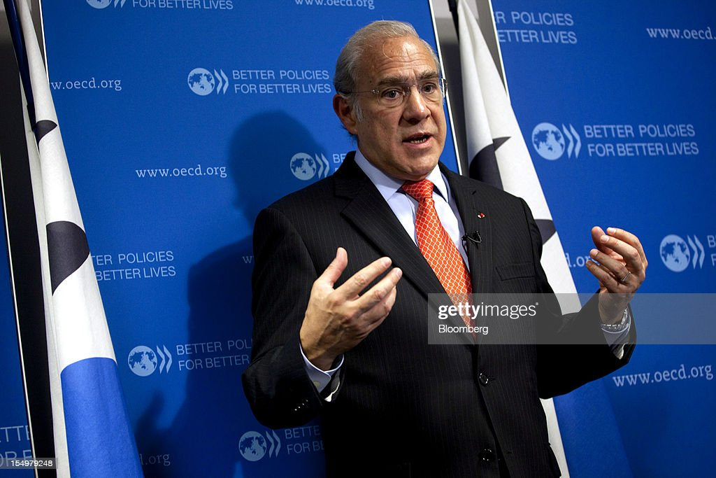 Jose Angel Gurria, secretary general of the Organization for Economic Cooperation and Development (OECD), gestures as he speaks during a news conference following a meeting hosted by the OECD in Paris, France, on Monday, Oct. 29, 2012. French President Francois Hollande said he wants the euro group of finance ministers to find a 'durable' solution to Greece's debt problems at their November meeting. Photographer: Balint Porneczi/Bloomberg via Getty Images