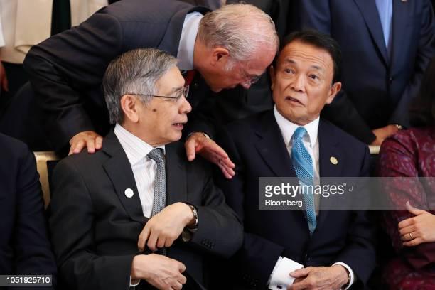 Jose Angel Gurria secretarygeneral of the Organization for Economic Cooperation and Development center speaks with Taro Aso Japan's deputy prime...