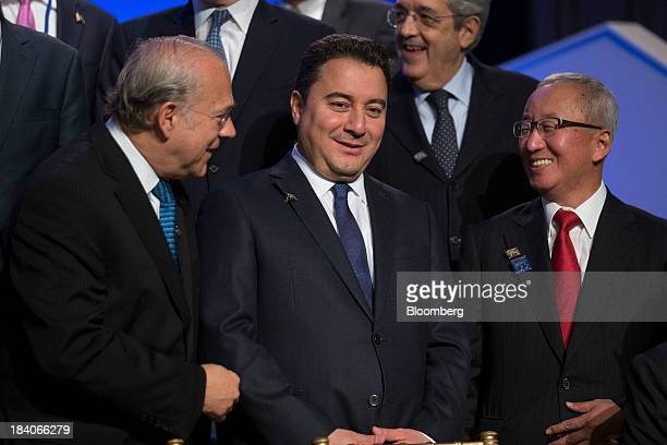 Jose Angel Gurria secretarygeneral of the Organization for Economic Cooperation and Development from left Ali Babacan Turkey's deputy prime minister...