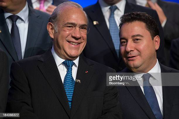 Jose Angel Gurria secretarygeneral of the Organization for Economic Cooperation and Development left and Ali Babacan Turkey's deputy prime minister...