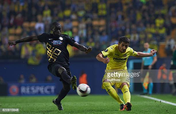 Jose Angel Jurado of Villarreal CF in action against Aminu Umar of Osmanlispor FK during the UEFA Europa League Group L football match between...