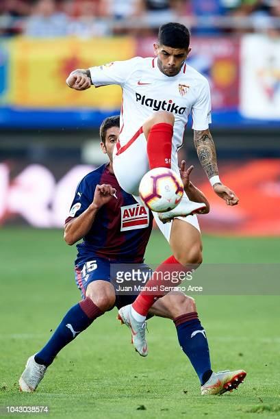 Jose Angel Valdes 'Cote' of SD Eibar duels for the ball with Ever Banega of Sevilla FC during the La Liga match between SD Eibar and Sevilla FC at...