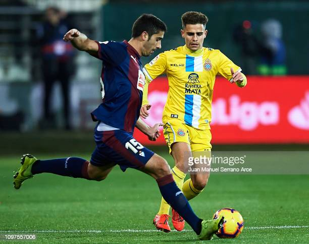 Jose Angel Valdes 'Cote' of SD Eibar duels for the ball with Oscar Melendo Jimenez of RCD Espanyol during the La Liga match between SD Eibar and RCD...
