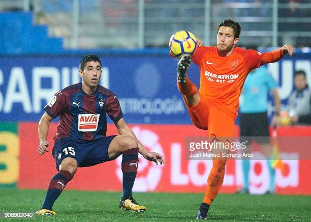 Jose Angel Valdes 'Cote' of SD Eibar duels for the ball with Sergio Gontan 'Keko' of Malaga CF during the La Liga match between SD Eibar and Malaga...