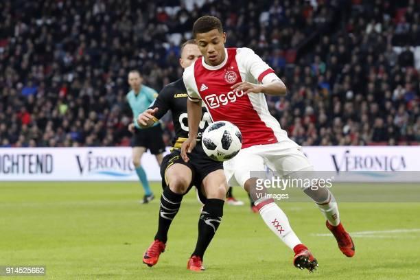 Jose Angelino of NAC Breda David Neres of Ajax during the Dutch Eredivisie match between Ajax Amsterdam and NAC Breda at the Amsterdam Arena on...