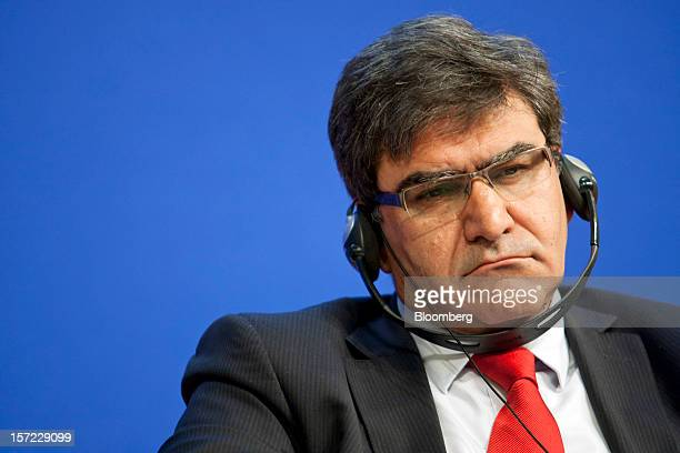 Jose Antonio Alvarez chief financial officer of Banco Santander SA listens via headphones to speakers during a financial conference at the Ministry...