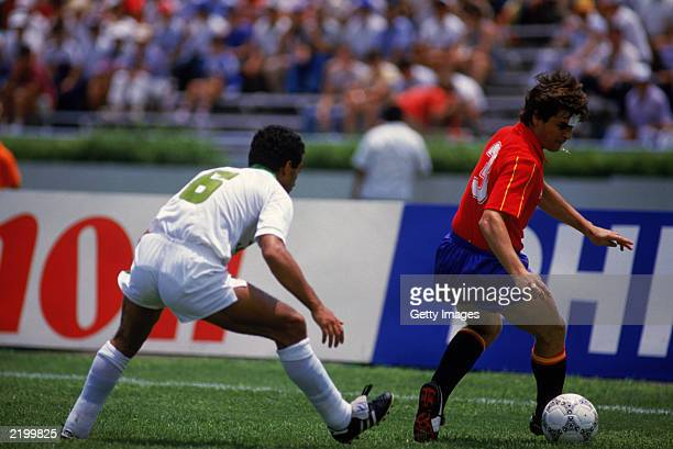 Jose Antonio Camacho of Spain looks to hold the ball up against Said Kaci of Algeria during the FIFA World Cup Finals 1986 Group D match between...