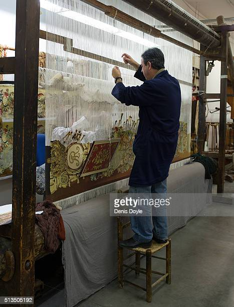 Jose Antonio Carbajal works on a tapestry for the rebuilt Residenzschloss in Dresden at the Royal Tapestry Factory on March 2 2016 in Madrid Spain...