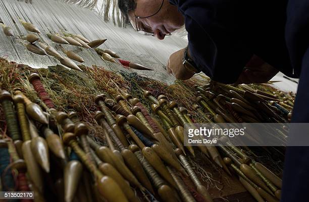 Jose Antonio Carbajal works with his weaving quills on a tapestry for the rebuilt Residenzscholss in Dresden at the Royal Tapestry Factory on March 3...