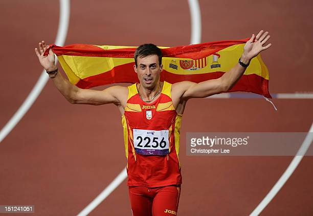 Jose Antonio Exposito Pineiro of Spain celebrates winning gold in the Men's Long Jump F20 Final on day 6 of the London 2012 Paralympic Games at...