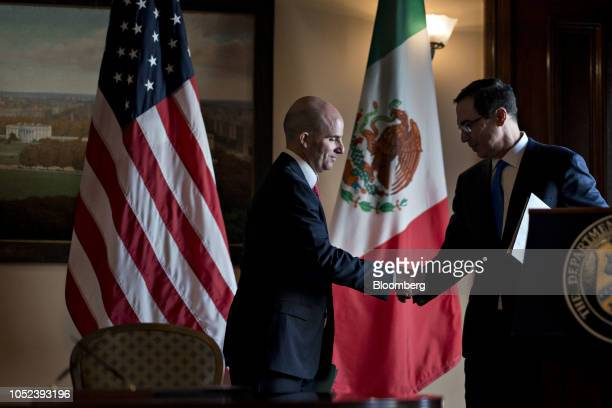 Jose Antonio Gonzalez Anaya Mexico's finance minister left shakes hands with Steven Mnuchin US Treasury secretary during a signing ceremony event at...