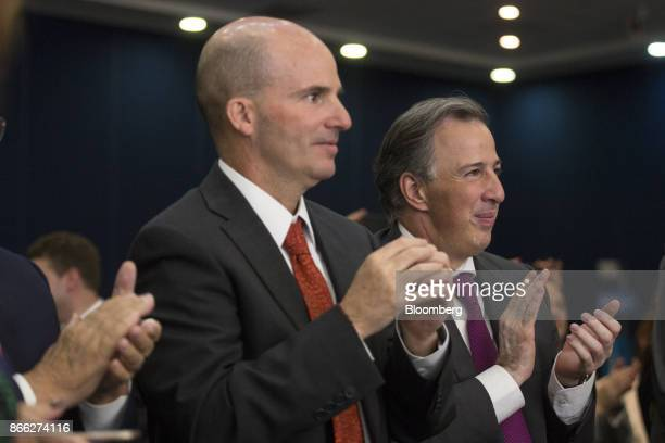 Jose Antonio Meade Mexico's finance minister right and Jose Antonio Anaya chief executive officer of Petroleos Mexicanos applaud during the Mexico...
