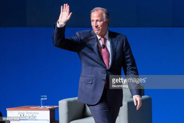 Jose Antonio Meade presidential candidate of the Institutional Revolutionary Party waves after speaking at the BBVA Bancomer SA national meeting of...