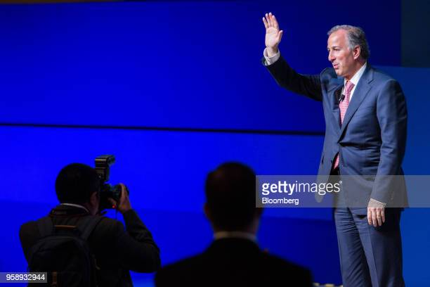 Jose Antonio Meade presidential candidate of the Institutional Revolutionary Party waves after speaking during the BBVA Bancomer SA national meeting...