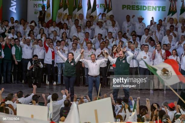 Jose Antonio Meade raises hands with Veronica Martinez Garcia and Jerico Abramo Masso candidates to the senate during the final event 2018 Election...