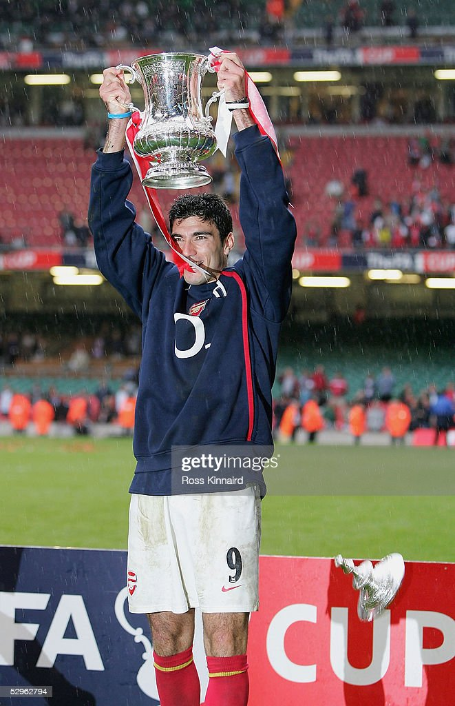 Jose Antonio Reyes of Arsenal holds the trophy aloft as the lid falls off after the FA Cup Final between Arsenal and Manchester United 5-4 on penalty's at The Millennium Stadium on May 21, 2005 in Cardiff, Wales.