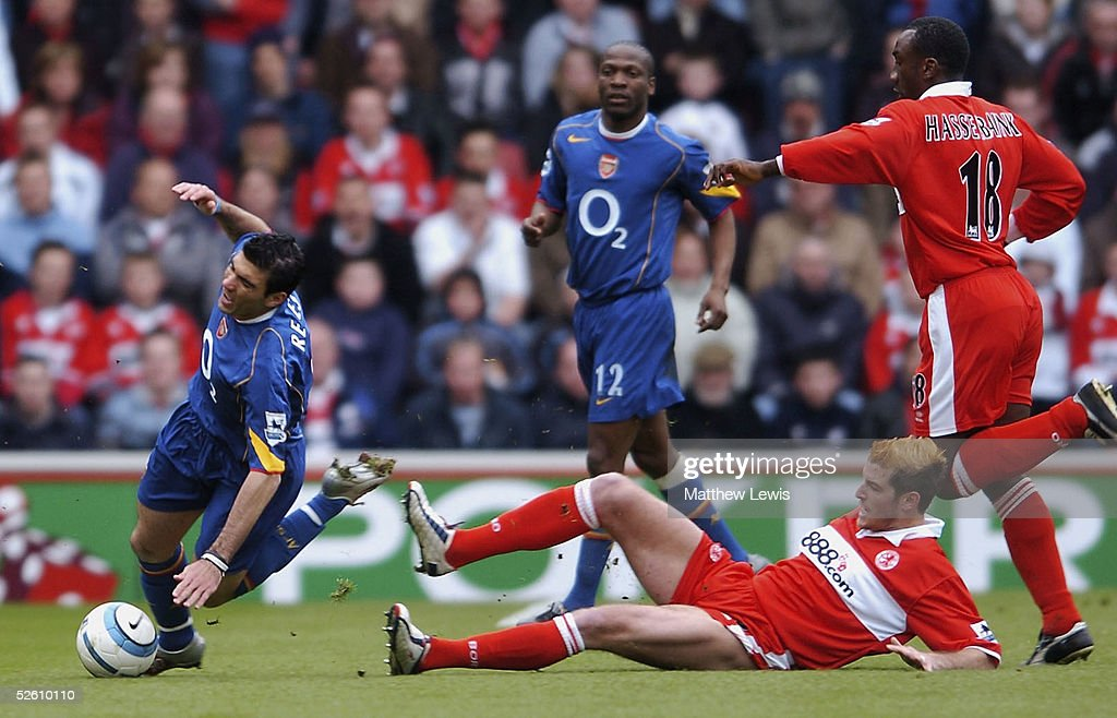 Jose Antonio Reyes of Arsenal is tackled by Franck Queudrue of Middlesbrough during the Barclays Premiership match between Middlesbrough and Arsenal at the Riverside Stadium on April 9, 2005 in Middlesbrough, England.