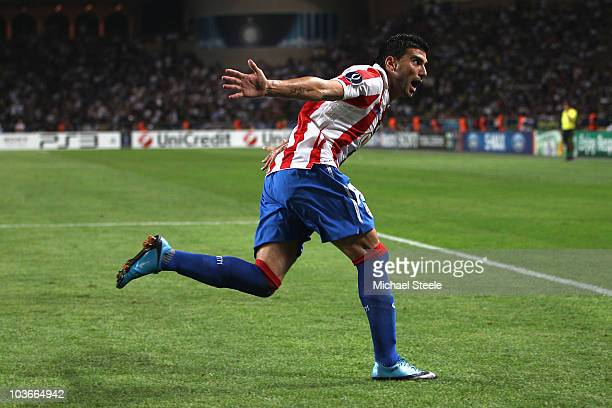 Jose Antonio Reyes of Atletico celebrates scoring the opening goal during the UEFA Super Cup match between Inter Milan and Atletico Madrid at Louis...