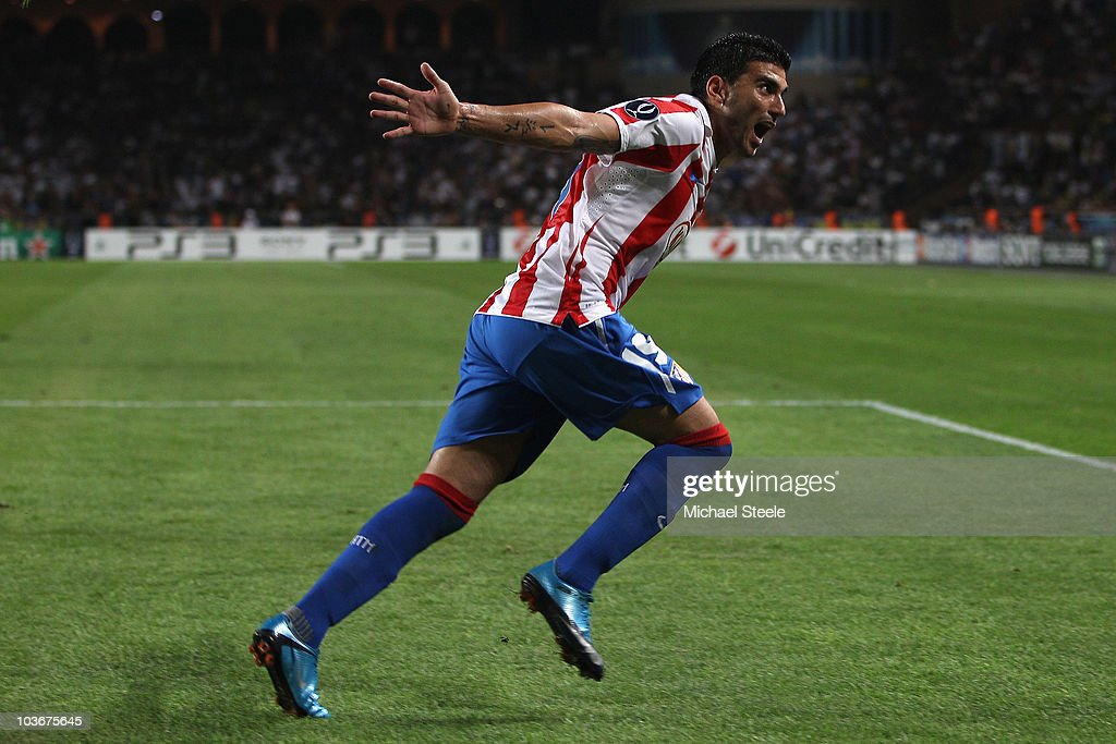 Jose Antonio Reyes of Atletico celebrates scoring the opening goal during the UEFA Super Cup match between Inter Milan and Atletico Madrid at Louis II Stadium on August 27, 2010 in Monaco, Monaco.