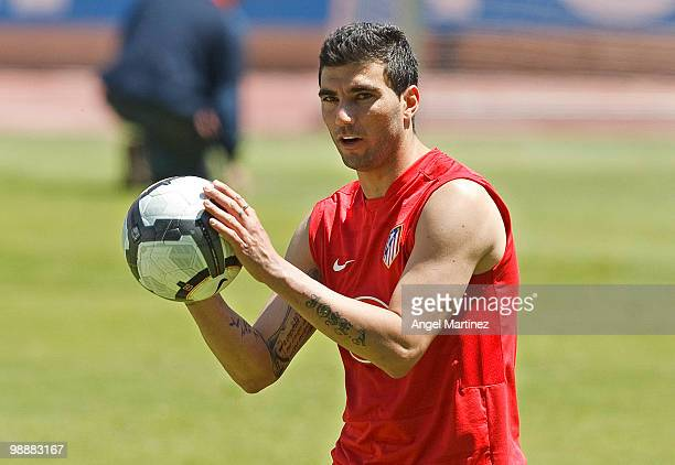Jose Antonio Reyes of Atletico Madrid holds a ball during a training session held ahead of next week's Europa League Final at Vicente Calderon...